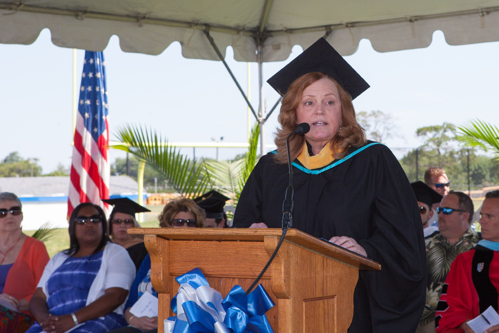 Superintendent Nancy Carney speaks at Riverhead High School's 2016 graduation ceremony. (Credit: Katharine Schroeder)