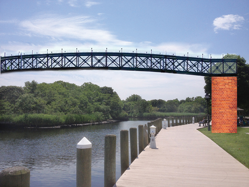 JAY SCHNEIDERMAN COURTESY RENDERING | The footbridge that would cross the Peconic River and connect Riverside to downtown Riverhead.