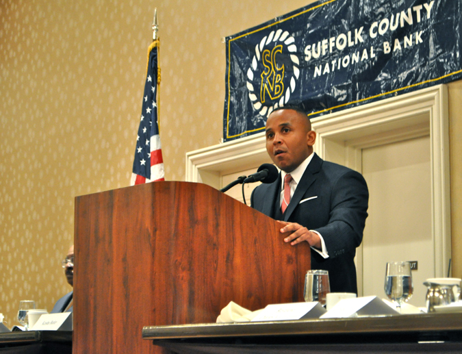 RACHEL YOUNG PHOTO | Rashad Robinson, executive director of ColorofChange.org, speaks at Monday's Martin Luther King, Jr. Memorial Breakfast.