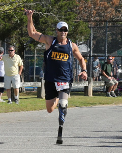 DANIEL DE MATO PHOTO | Tommy Kohler of Hampton Bays, running with a prosthetic left leg, took second place in the 5K race.
