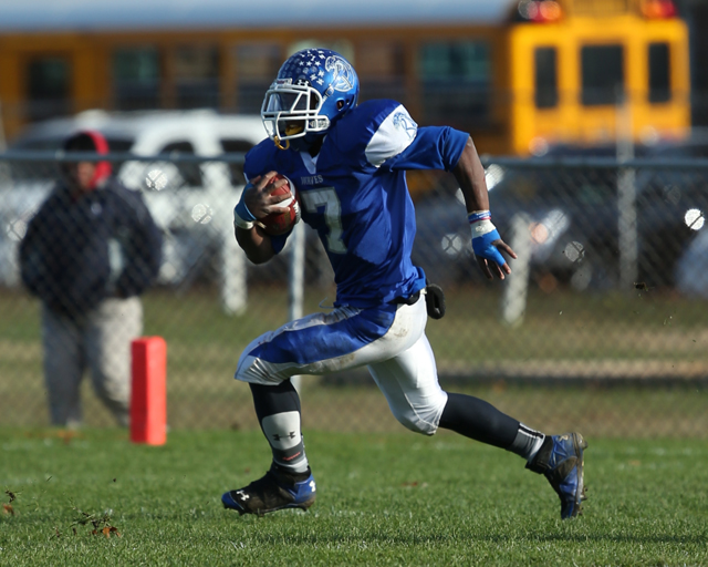 Riverhead running back Ryun Moore picks up a first down in the Blue Waves' playoff win against Deer Park Saturday. (Credit: Daniel De Mato)
