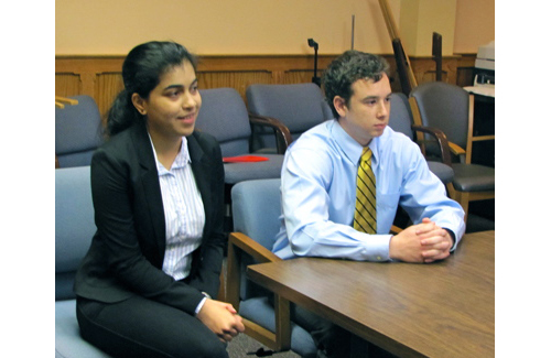 Stony Brook business students Neha Shethia and Justin Kline present their EPCAL study to the Town Board Thursday. (Credit: Tim Gannon)