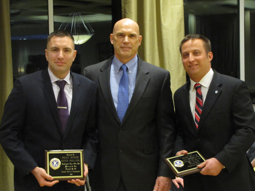 Southampton Town Officer Keith Phillips, left, Captain Larry Schurek, and Officer Eric Breitwieser at Friday's Police Awards ceremony in Riverhead