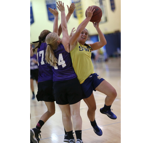 Shoreham-Wading River Alex Hutchins faces double-team pressure during her the Wildcats' 43-30 win over Sayville. (Credit: Garret Meade)