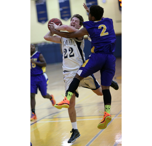 Greenport's Darius Bolling (2) tries to stop Shoreham-Wading River's Dan Hughes, one of three 11-point scorers for the Wildcats. (Credit: Garret Meade)