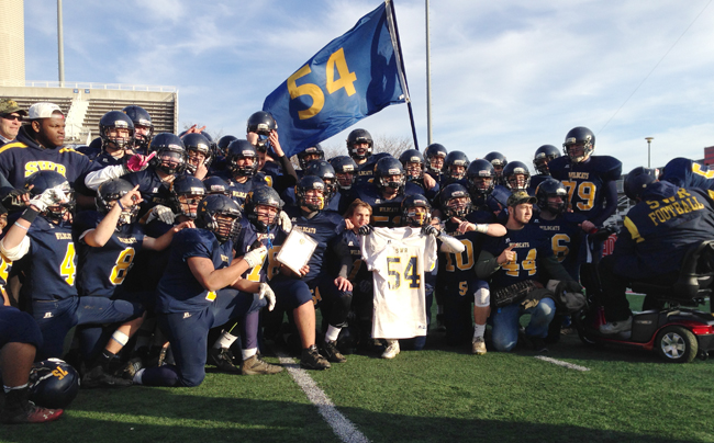 The Shoreham-Wading River football team after winning the Division IV county title Saturday at Stony Brook. (Credit: Joe Werkmeister)
