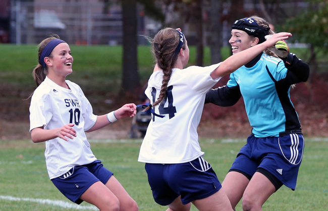Shoreham-Wading River goalkeeper Lydia Kessel is mobbed by teammates Samantha Higgins (14) and Haley Rose after Friday's win. (Credit: Daniel De Mato)