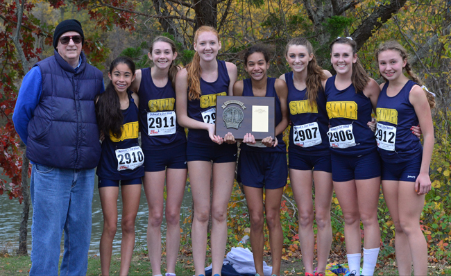 The Class B county champion Shoreham-Wading River girls cross country team. Pictured are (from left) coach Paul Koretzki, Francesca Lilly, Kaitlyn Ohrtman, Alexandra Hays, Katherine Lee, Amanda Dwyer, Payton Capes-Davis and Lexie Smith. (Credit: Robert O'Rourk)