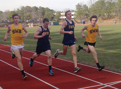 Shoreham-Wading River runners (from left) Ryan Udvadia, Connor McAlary, Keith Steinbrecher and Michael Godfrey cross the finish line in the 1,600 Tuesday against John Glenn.
