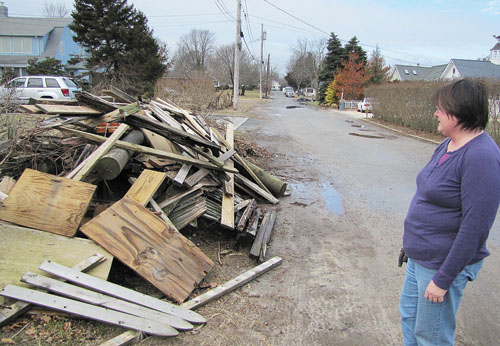 TIM GANNON PHOTO  |  A giant pile of superstorm Sandy debris has sat in front of Sheila Ganetis' Morningside Avenue home in Jamesport for almost two months. Town officials say she'll need to pay to get the junk removed.