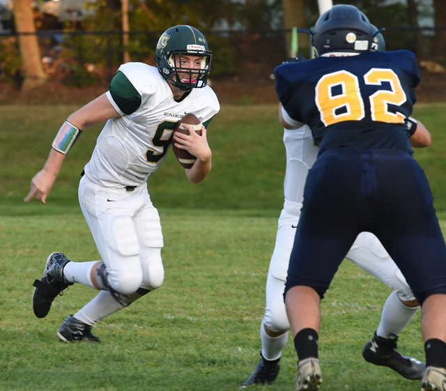 Mercy quarterback Kevin Santacroce carries the ball against Shoreham. (Credit: Robert O'Rourk)