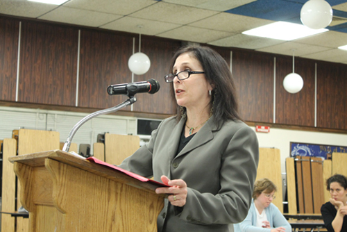PAUL SQUIRE PHOTO | Jill Sanders, a certified accountant with Cullen & Danowski LLP, delivers positive news to the Riverhead school board Tuesday night.