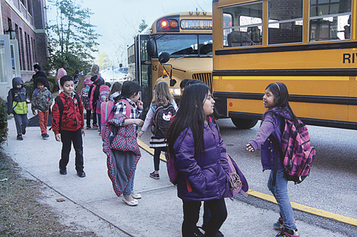 Students leaving Roanoke Avenue Elementary School to board the buses Monday afternoon. (Credit: Barbaraellen Koch)