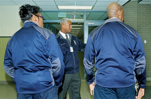 Security director James Gersham discusses procedures with two members of his staff Marilyn Ross (left) and Eddie Johnson Monday afternoon. (Credit: Barbaraellen Koch)