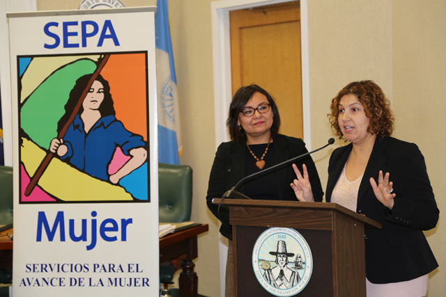 Siris Barrios of Riverside Rediscovered speaks next to SEPA Mujer director Martha Maffei. (Credit: Joe Werkmeister)