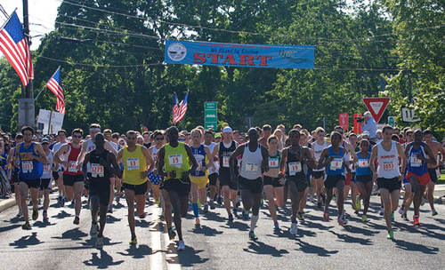 GARRET MEADE PHOTO | Runners hit the course at the start of the 34th annual Shelter Island 10K Run.