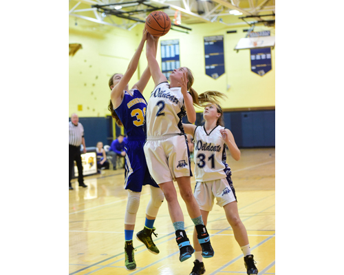 Shoreham-Wading River's Courtney Clasen battles for a rebound with Comsewogue's Sam Collins. Sam Higgins stood nearby. (Credit: Robert O'Rourk)
