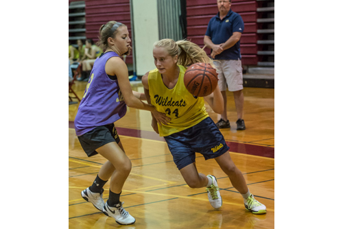 ROBERT O'ROURK PHOTO | Shoreham-Wading River's Courtney Clasen driving to the basket during her team's summer league semifinal win over Sayville on Monday evening.