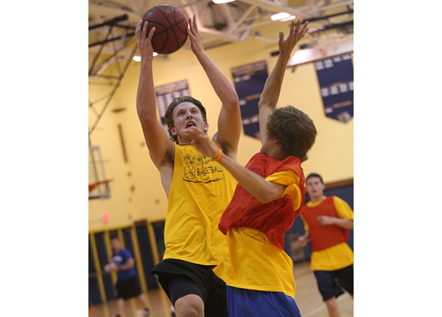 Dan Hughes, attacking the basket during Shoreham-Wading River's intrasquad scrimmage last Thursday night, has ball skills to go with his 6-foot 5-inch frame. (Credit: Garret Meade)