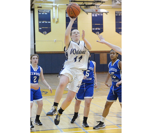 ROBERT O'ROURK PHOTO | Kari Gostic of Shoreham-Wading River passed Elwood/John Glenn defenders before putting up a shot.
