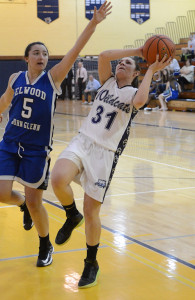 ROBERT O'ROURK PHOTO | Shannon Rosati of Shoreham-Wading River attempting an off-balance shot while Elwood/John Glenn's Mackenzie Sivilli tries to stop her.