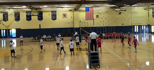 Shoreham-Wading River (white shirts) lines up for its match against Smithtown East on Thursday. (Credit: Bob Liepa)