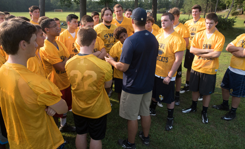 Shoreham-Wading River coach Matt Millheiser addressing his players following a water break. (Credit: Robert O'Rourk)