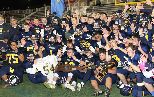 Shoreham-Wading River honored the memory of a fallen player by winning its first Long Island championship last year and going 12-0. (Credit: Daniel De Mato, file)