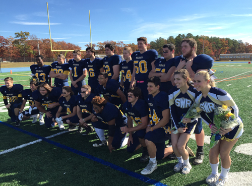 Shoreham-Wading River's 19 senior football players and two senior cheerleaders participated in a pregame senior day ceremony. (Credit: Bob Liepa)