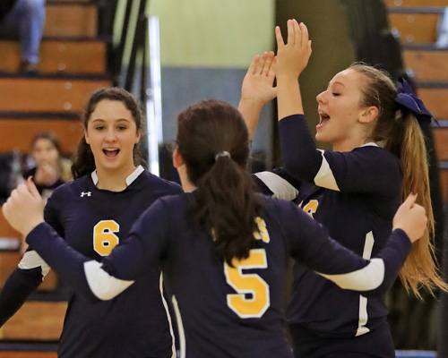 Courtney Wrigley #16 (right) celebrates a point with her teammates during the second set of Shoreham Wading River's three set loss to Sayville at Shoreham Wading River High School in Shoreham on Oct. 27, 2016.