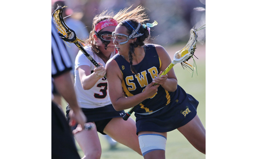 Shoreham-Wading River's Manuela Cortes is guarded closely by Mount Sinai's Mary Ellen Carron. (Credit: Garret Meade)