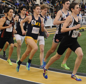 ROBERT O'ROURK PHOTO | Shoreham-Wading River junior Ryan Udvadia moved up from the middle of the pack and finished second in the 1,600 meters in a personal-best time of 4 minutes 17.26 seconds.