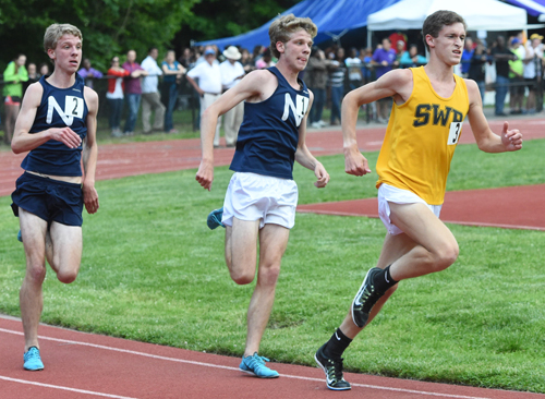 Shoreham-Wading River's Ryan Udvadia passed Northport's brothers on the last lap before coming in first place in the 3,200 meters. (Credit: Robert O'Rourk)