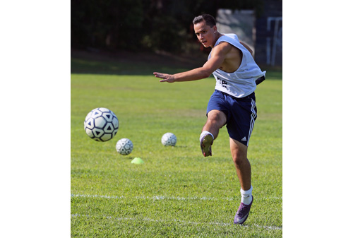 Shoreham-Wading River's top goal scorer from last year, all-county player Doug DeMaio, shooting during a drill at Tuesday's practice. (Credit: Daniel De Mato)