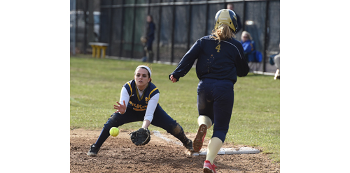 Shoreham-Wading River second baseman Stevie Michelli, covering first base on a bunt. Bayport-Blue Point's Savanna Neuhaus was called out on the play. (Credit: Robert O'Rourk)