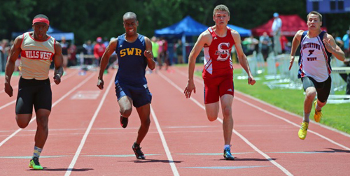 From left, Half Hollow Hills West's Jarried Redwood, Shoreham-Wading River's Jordan Wright, Smithtown East's Shane Harris and Smithtown West's Andrew Lapreziosa lunging toward the finish line in the 100-meter dash finals. (Credit: Daniel De Mato)