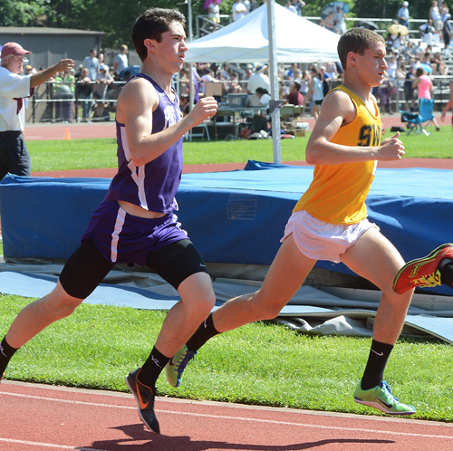 ROBERT O'ROURK PHOTO | Port Jefferson's James Burke, left, ran around Shoreham-Wading River's Ryan Udvadia about 1,200 meters into the 1,600-meter final.