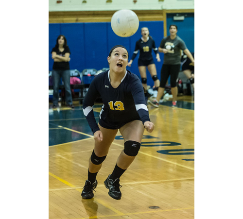 Shoreham-Wading River's Sarah Fabian goes far out of bounds to keep the ball in play during the third game. (Credit: Robert O'Rourk)