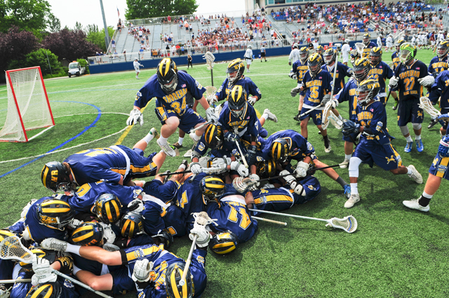 The Shoreham-Wading RIver boys lacrosse team dogpiles following its Long Island championship voctory Saturday. (Credit: Bill Landon)