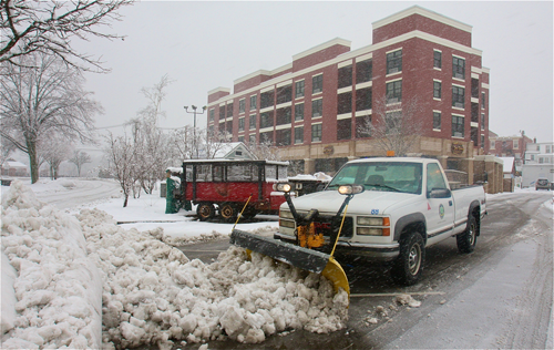 Gary Hubbard, B&G worker, clearing the heavy slushy snow from the town parking lot by Summerwind Apartments. (Barbaraellen Koch Photo)