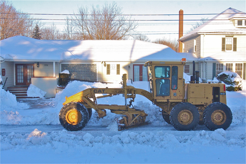 BARBARAELLEN KOCH PHOTO  |  Highway Superintendent Gio Woodson uses heavy equipment to clear Marcy Avenue at 4:30 Saturday afternoon.