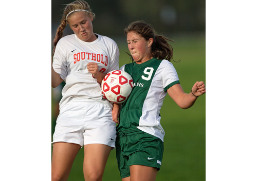 Southold/Greenport's Jill Golden and Bishop McGann-Mercy's Alexandra Hulse competing for the ball during Monday's 2-2 draw. (Credit: Garret Meade)