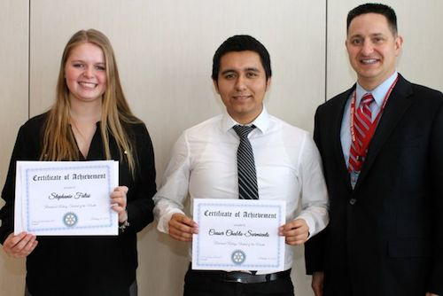 From left, Riverhead High School seniors Stephanie Falisi and Ceaser Chabla-Sarmiento with assistant principal Sean O'Hara at the Feb. 12 Riverhead Rotary Club luncheon. (Credit: Riverhead Rotary)