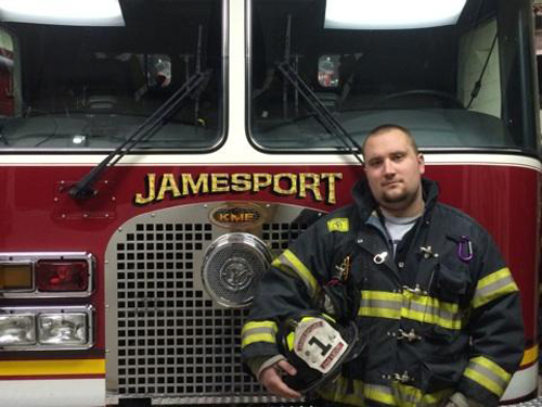 Lt. Stevie Czelatka Jr. in front of a Jamesport fire engine. (Courtesy file photo)