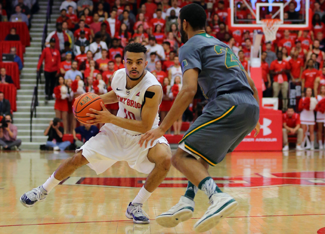 Stony Brook guard Carson Puriefoy drives to the net during the second half of Stony Brook's American East Championship victory over Vermont at Stony Brook University's Island FCU Arena Sunday. (Credit: Daniel De Mato)