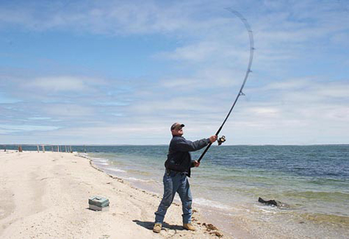 A surf fisherman at Iron Pier Beach on the Sound. (Credit: Barbarallen Koch file photo)