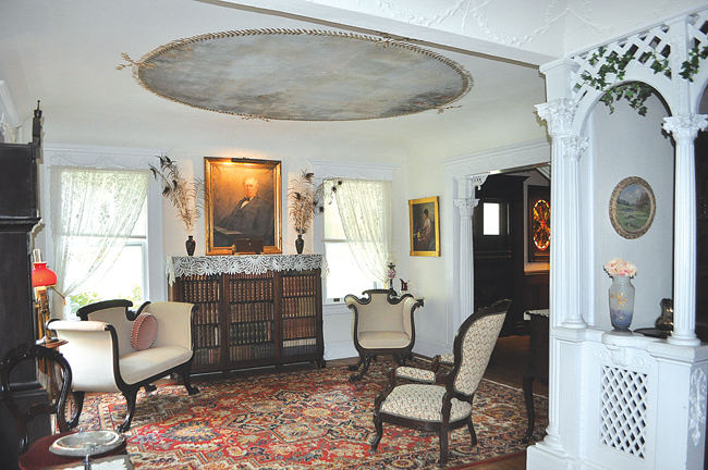 The Thomas Moore House, built around 1750 and named for the original owner of the land, is one of the historical society's oldest properties. The cape-style house has been fully restored to reflect life in the 18th century and features an original stove, pictured here. A room at the back of the house that functioned as a kitchen in the 1800s now contains a large loom used to exhibit examples of early weaving. (Credit: Rachel Young)