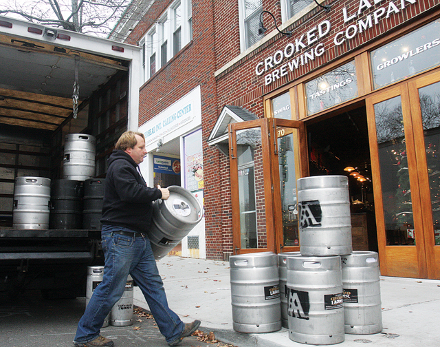 Crooked Ladder co-owner Duffy Griffiths unloading empty kegs at Crooked Ladder in December. (Credit: Barbaraellen Koch)