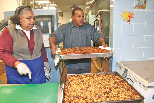 Long Island Council of Churches office manager Carolyn Gumbs and volunteer MIchael Lacy of Shinnecock Reservation in Southampton preparing side dishes for the annual Migrants Dinner last November. (Credit: File)