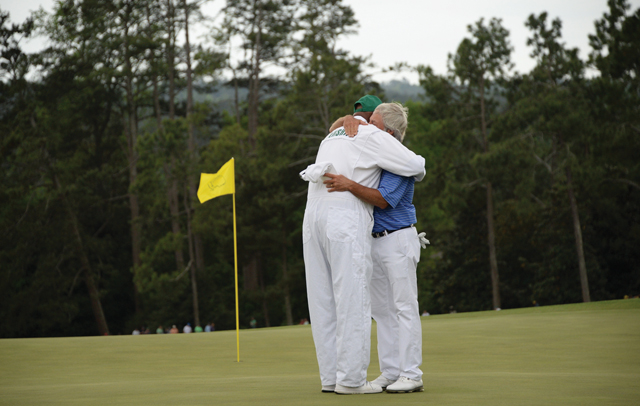 Embracing the moment: Hall of Famer Ben Crenshaw hugs his longtime caddy, Carl Jackson. Crenshaw played in his 44th and final Masters Golf Tournament at Augusta National Golf Club. (Credit: Jim Watson/AFP/Getty Images)